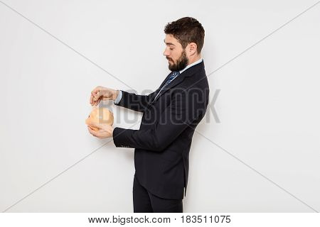 Elegant Man With Piggy Bank On White Background
