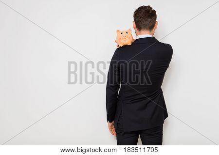 Elegant Man With Piggy Bank On White Background
