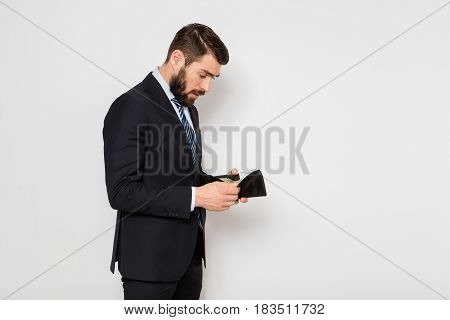Elegant Man Checking His Wallet On White Background