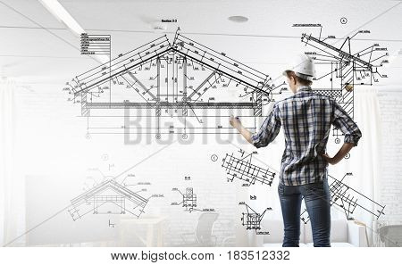 Engineer woman draw layout