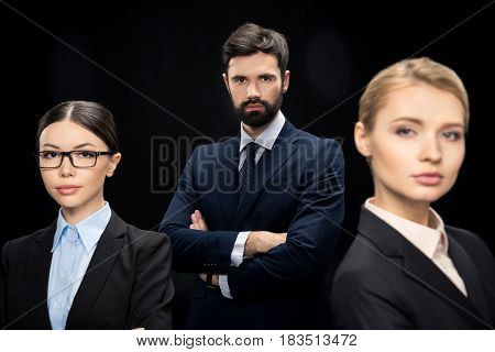Business Team Standing With Crossed Arms Isolated On Black, Business Establishment Concept