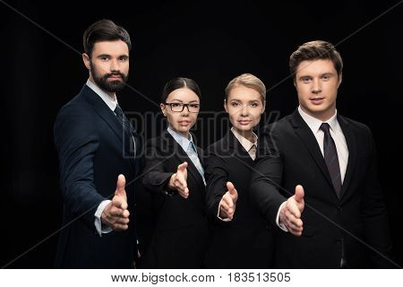 Business Team Stretching Out Hands For Shaking Isolated On Black,  Business Establishment Concept