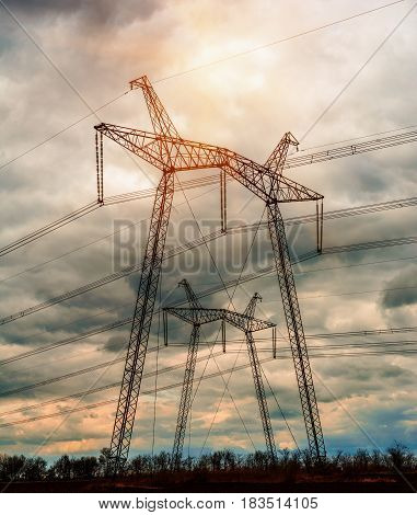 Power Line. pylon against a blue sky.
