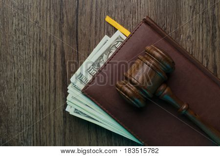 Judge's hammer, folder with banknotes