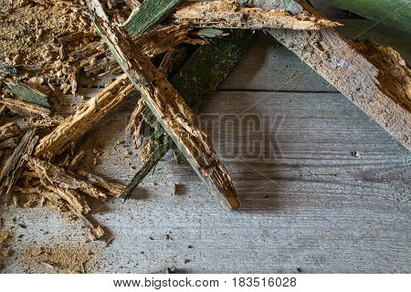 Old heap of old broken wood boards with old nails. Texture background. Pile of wood