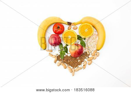 The heart shape by various vegetables and fruits. Concept of diet and healthy eating