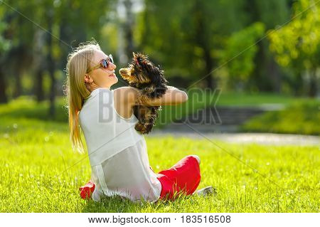 Dog and his owner - Cool dog and young women having fun in a park - Concepts of friendshippetstogetherness.
