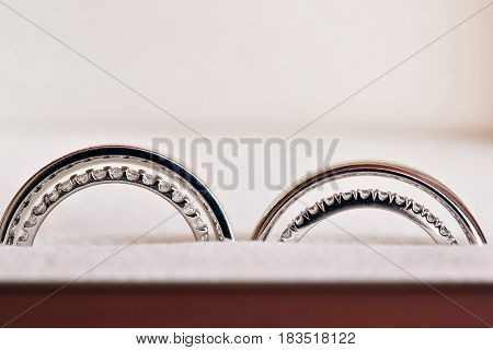 Two wedding rings in infinity sign. Love concept. the wedding of two sisters twins.