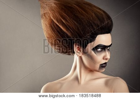 beautiful woman with fashion hairstyle and creative makeup