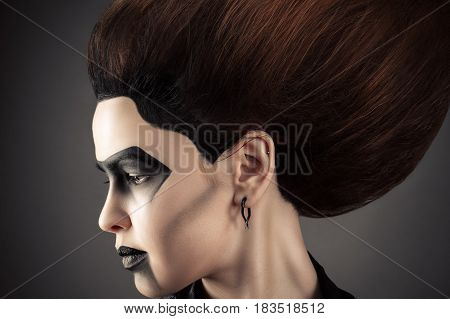 beautiful profile face woman with dark fashion makeup
