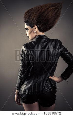 luxury woman with lush hair in leather jacket