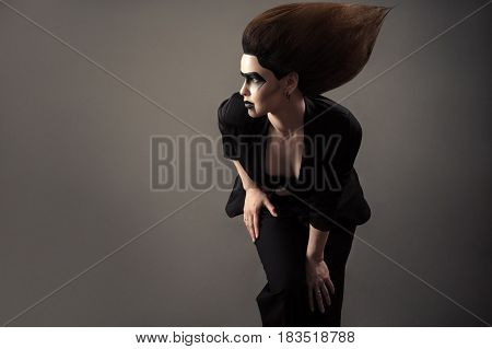 charming brunette woman with lush hair isolated on gray
