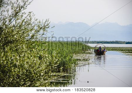 Boat with tourists while traveling on Lake Skadar