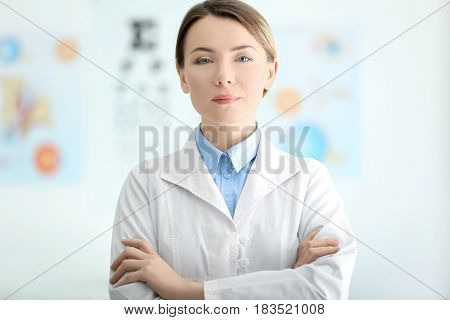 Female ophthalmologist doctor standing in office