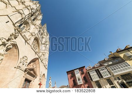 BURGOS, SPAIN - JULY 28, 2016: Burgos (Castilla y Leon Spain): exterior of the medieval cathedral in gothic style and houses with the typical verandas