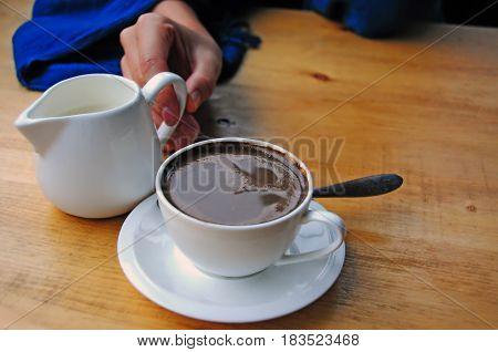 Turkish Coffee: A woman enjoying a cup of Turkish Coffee in a cafe in the Svaneti area - Mestia, Georgia.