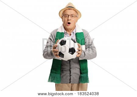 Excited elderly soccer fan with a scarf and a football cheering isolated on white background