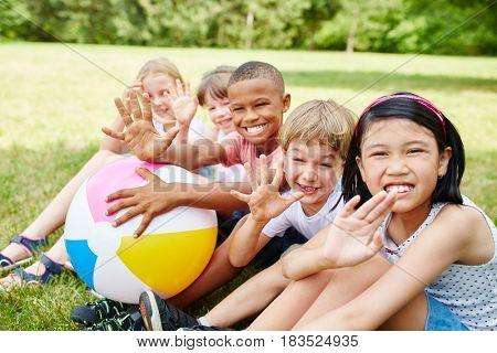 Group interracial children in international kindergarten in summer