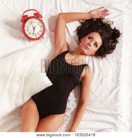 Sexy Girl Lazy Woman Lying With Clock On Bed