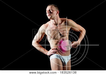 Man Suffers From Bellyache Standing Over Black Background