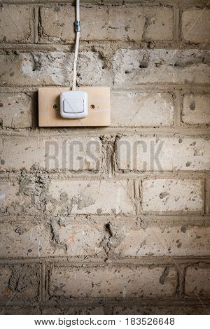 Grunge Background. Part Of Old Dirty Brick Wall And Electric Switch Attached To It.