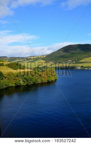 Rolling hills surrounding Loch Ness in Scotland.