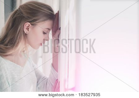 Pretty Girl Leaned Against Window Frame