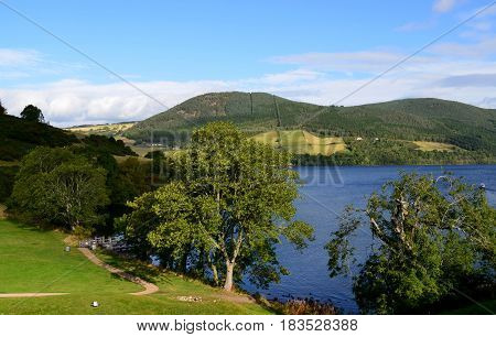 Scotland's rolling green hills surrounding the intriquing Loch Ness.