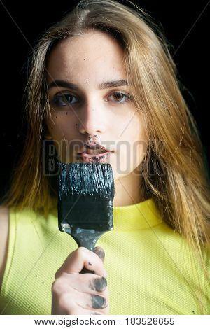 Pretty Girl Builder, Painter With Black Paintbrush, Has Dirty Face