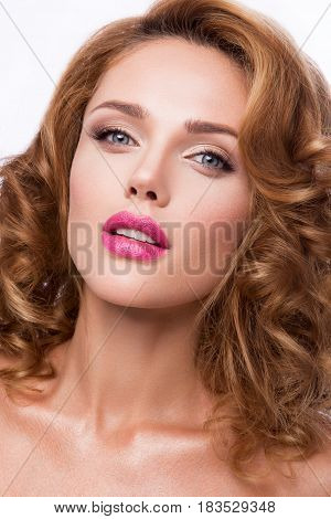 Glamour portrait of beautiful girl model with makeup and romantic wavy hairstyle. Fashion shiny highlighter on skin, sexy gloss lips make-up and dark eyebrows. poster