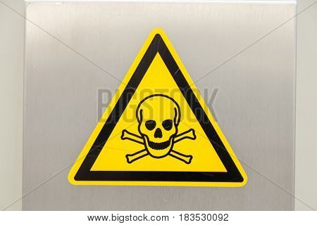 Yellow Warning Sign with Skull