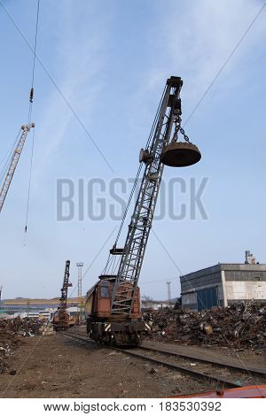 Slavynka Russia - April 14th 2017: Port Slavynka ship-repair factory the crane on rails with the electromagnetic loading device.