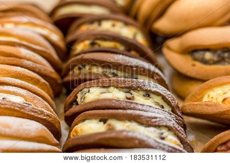 Many Pies or cookies with filling on market shelf, Sweet pastry background, selective focus