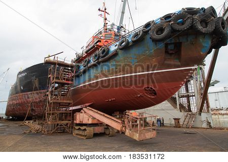 Slavynka Russia - April 21th 2017: Port Slavynka ship-repair factory sea ship-repair dock with courts and a chain with an anchor on a deck.