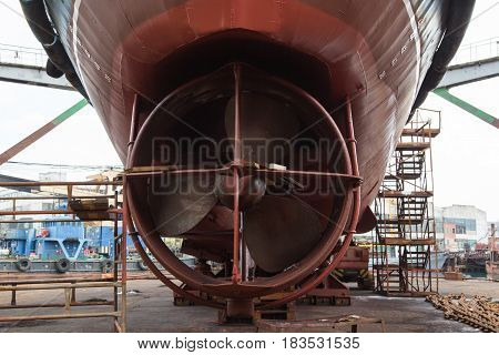 Slavynka Russia - April 21th 2017: Port Slavynka ship-repair factory sea ship-repair dock with a vessel in it the vessel screw.