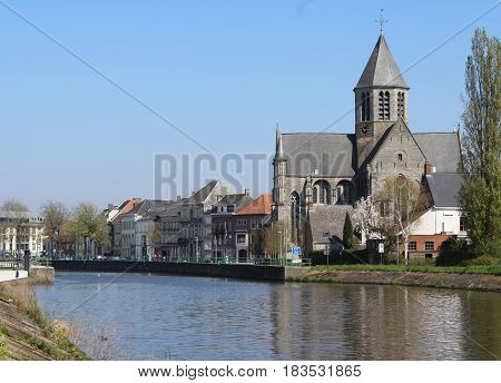 View of the river Schelde and church of Our Lady in Oudenaarde, East Flanders, Belgium