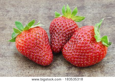 fresh strawberries on a metal tray background