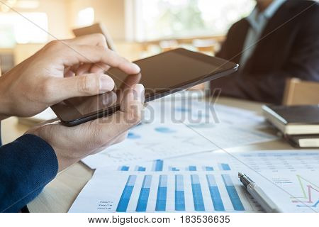 Team job succes. Closeup photo young hands business managers holding tablet working with new startup project in office.Analyze document plan.