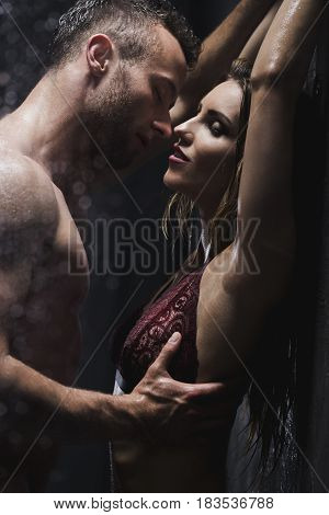 Man Touching Woman's Breasts