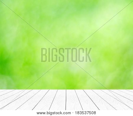 Empty perspective white wood table over blur green tree abstract background product display montage background