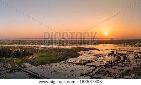 Aerial View of Esteiro da Tojeira at sunset near the Aveiro Lagoon at Murtosa Aveiro Portugal