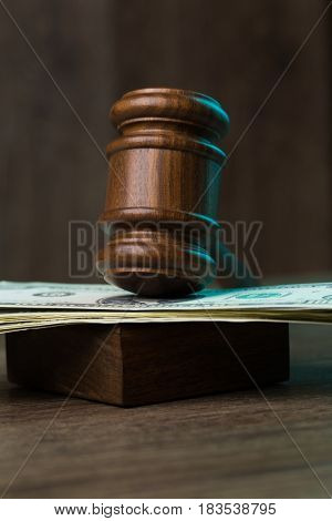 Hammer on banknotes at table