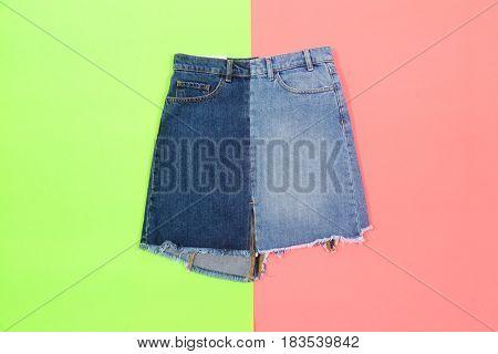 Blue denim skirt,shorts isolated on yellow background