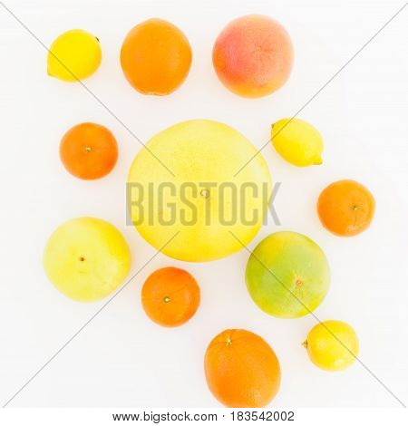 Lemon, orange, mandarin, grapefruit, sweetie and big pomelo fruit on white background. Flat lay, top view.