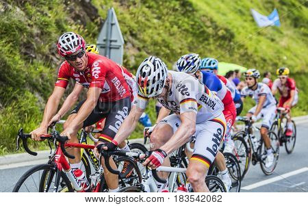 Col de PeyresourdeFrance- July 23 2014: Adam Hansen and Andre Greipel of Lotto-Belisol Team discussing while climbing the road to Col de Peyresourde in Pyrenees Mountains during the stage 17 of Le Tour de France on 23 July 2014.