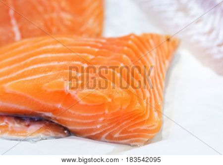 Fresh Uncooked Salmon Fillet On Showcase Of Seafood Market.