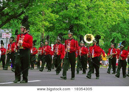 A group of band men playing at a local parade