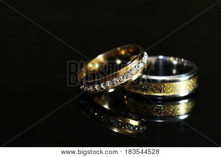 Wedding Rings On A Black Glossy Background