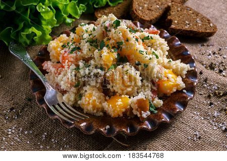 Homemade Fresh Couscous salad with tomatoes in plate