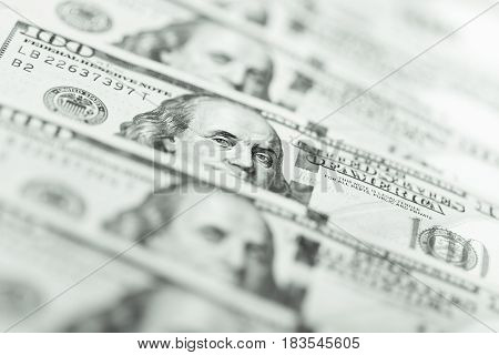 Row of one hundred US dollar bills. Macro shot